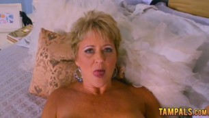 Busty mature blonde rubbing her clit