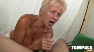 Busty Blonde Bimbo Sucking a Hard Dong