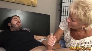 Nasty blonde GILF gives a handjob
