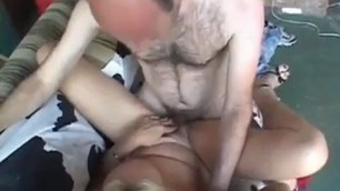 Mature blonde woman is sucking her partners dick